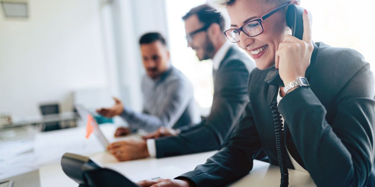 businessperson in office on phone