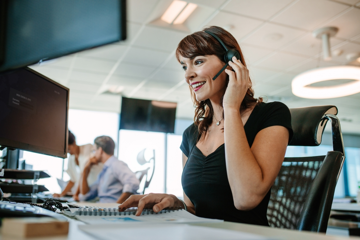 woman on phone headset in office