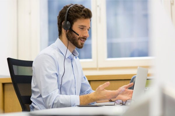 Man in office talking on phone headset