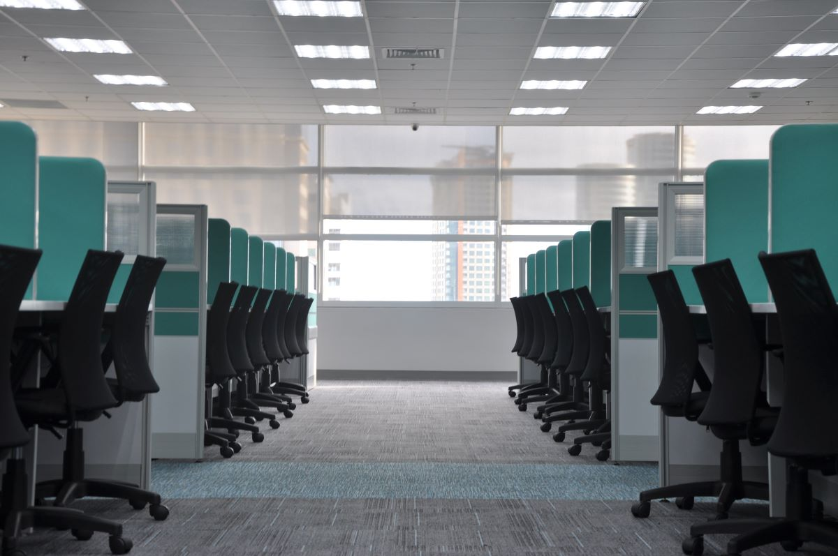 clean office with lines of empty cubicles