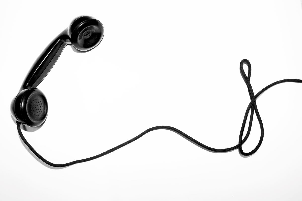 black corded phone on white background