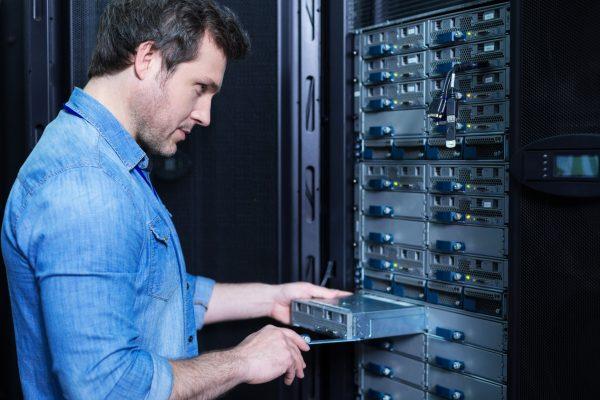 Man installing blade server