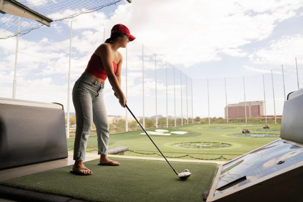 Woman Golfing at Driving Range Course