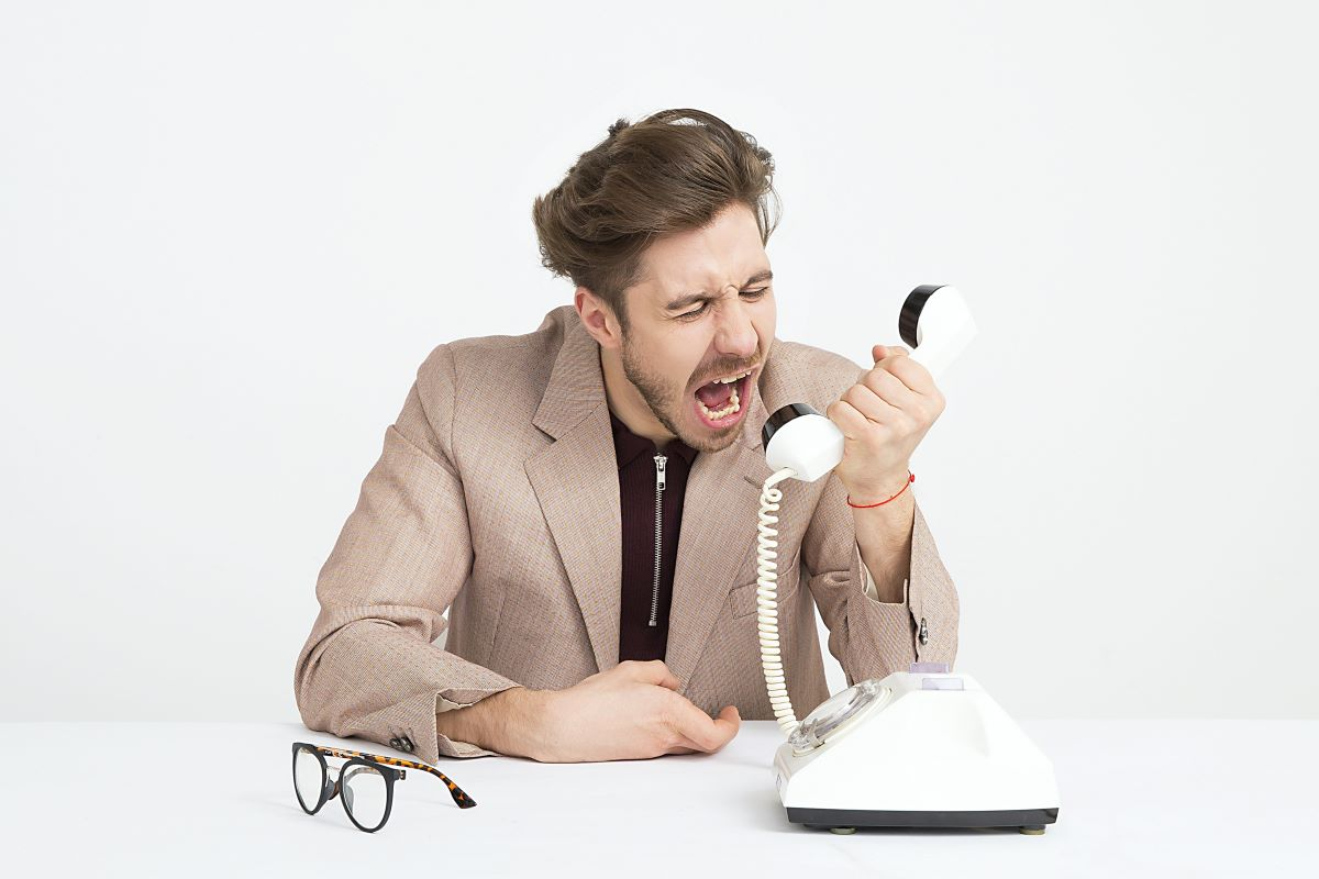angry man yelling at phone