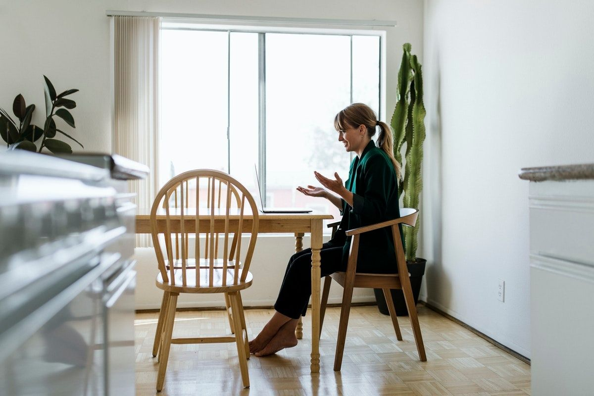 Woman on conference call at dining room table