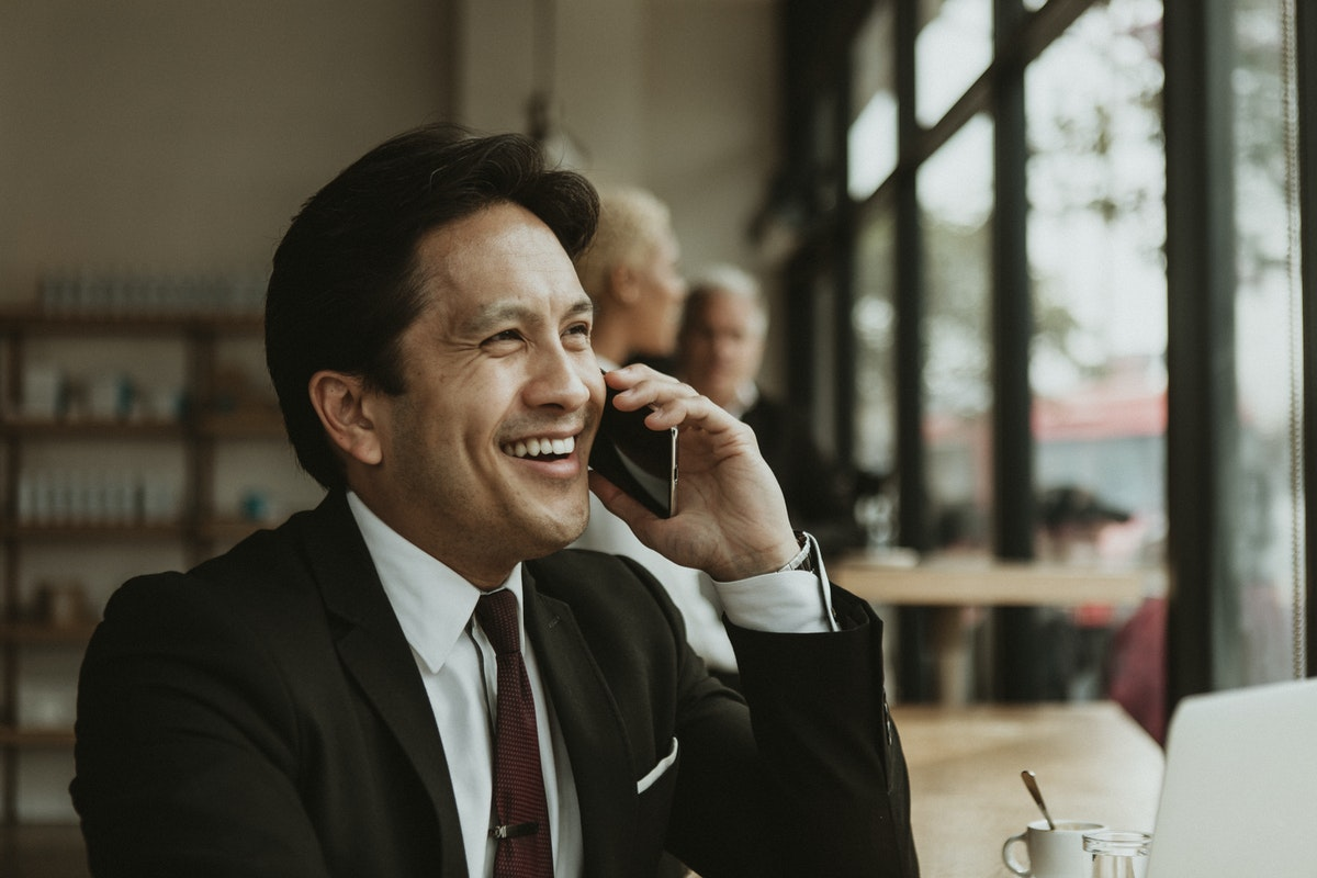 Man smiling and talking on his cell phone softphone app