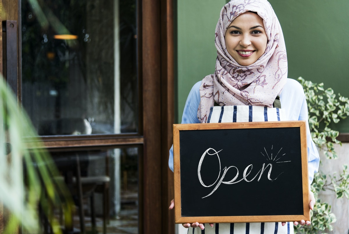 woman holding open sign small business concept