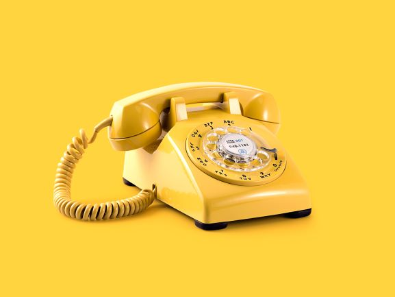 yellow telephone on yellow background