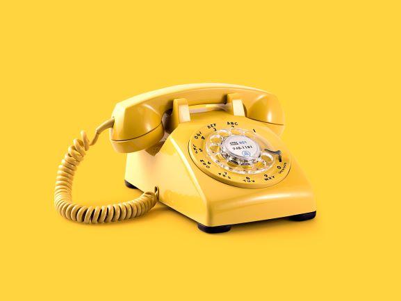 yellow telephone on yellow background