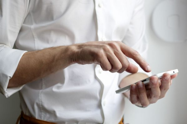 Man tapping on mobile phone